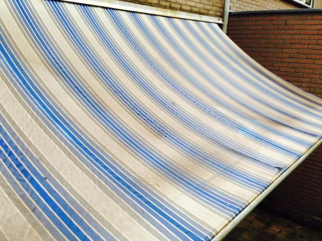 zonnescherm reinigen schoonmaken zonwering
