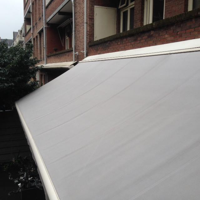 uitvalzonnescherm appartement reinigen zonwering