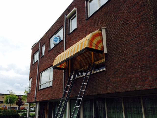 Reiniging vervuilde markies woonhuis Friss voor Zonwering